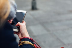 Woman texting message on her mobile phone Stock Photo