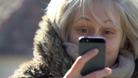 Woman Texting A Message On A Smart Phone stock video footage