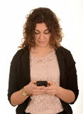 Woman texting on a mobile Royalty Free Stock Photography