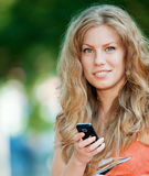 Woman texting on mobile phone Royalty Free Stock Photography