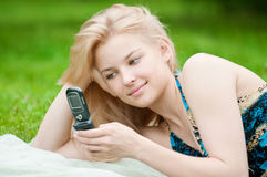 Woman texting on mobile phone Stock Photo