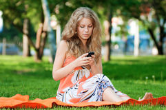Woman texting on mobile phone Stock Images