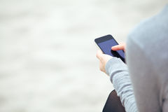 Woman texting on a mobile phone Royalty Free Stock Images