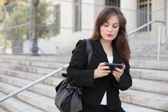 Woman texting on the phone Royalty Free Stock Photo