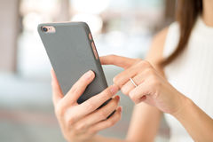 Woman texting on phone Royalty Free Stock Image