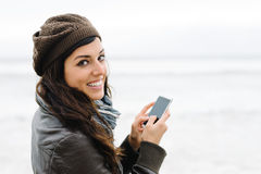 Woman texting on smartphone Royalty Free Stock Photography