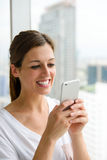 Woman texting on smartphone Stock Photo