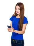 Woman texting with smartphone Stock Photo
