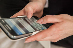 Woman texting sms Stock Images
