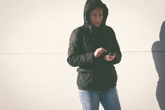 Woman texting SMS message on mobile phone Royalty Free Stock Photo