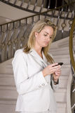 Woman texting on stairs Royalty Free Stock Images