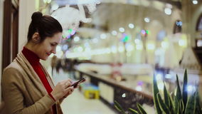 Woman texting, using smartphone in mall. stock video footage