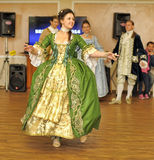 Woman in 19th century costume dances Royalty Free Stock Image