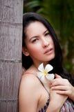 Woman with Thai flower, Frangipani, Plumeria, Royalty Free Stock Photo