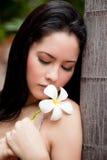 Woman with Thai flower, Frangipani, Plumeria, Royalty Free Stock Photography