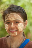 Woman with thanaka on her face in Myanmar. Stock Photo