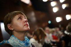 Woman in theater. Portrait of a woman in a theater Royalty Free Stock Photo
