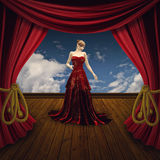 Woman on theater stage Royalty Free Stock Image