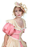 Woman in a theatrical dress. Woman in a theatrical pink and cream dress and bonnet Royalty Free Stock Photos