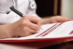 Woman Therapist Filling Medical Form. Patient. Close Up Stock Image