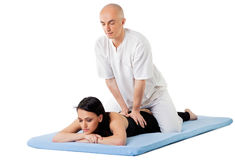 Woman therapist thai massage Royalty Free Stock Image