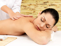 Woman on therapy massage of back in spa salon Royalty Free Stock Photography