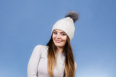 Woman in thermal underwear. Attractive woman in winter cap and gray sports thermolinen underwear for skiing training studio shot on blue. Long sleeves top Royalty Free Stock Photos