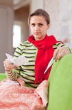 Woman with thermometer and medications Stock Image