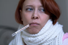 A woman with a thermometer Stock Photo