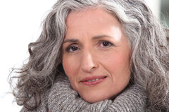 Woman with thick grey hair. Portrait of a woman with thick grey hair stock images