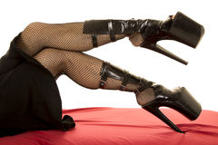 Woman with thick heels legs out fishnet Stock Photography