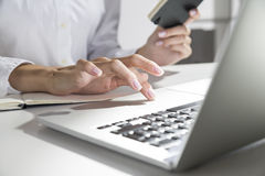 Woman with thin fingers is using touchpad Royalty Free Stock Photo