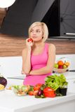 Woman think, cook in modern kitchen Stock Photography