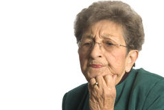 Woman thinking. Emotional senior woman deep in thought stock photo