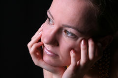 Woman thinking. Extremely close portrait of a thinking woman Royalty Free Stock Photography