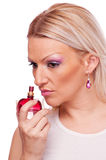 Woman thinking abour perfume Royalty Free Stock Photos