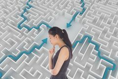 Woman thinking against background with a maze Royalty Free Stock Images
