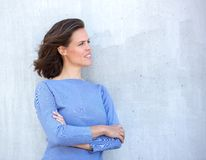 Woman thinking with arms crossed Royalty Free Stock Images
