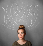 woman thinking with arrows in different directions above her head Stock Photo
