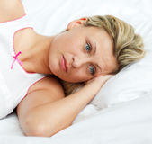 Woman thinking in a bed Royalty Free Stock Image