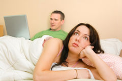 Woman Thinking In Bed Stock Images