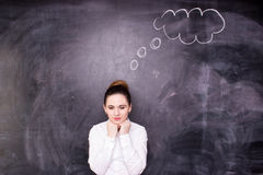 Woman thinking, blackboard concept royalty free stock photos