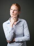 Woman Thinking of Business Solutions Royalty Free Stock Photography