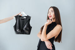 Woman thinking about buying clothes Royalty Free Stock Images