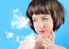 Woman Thinking with Clouds Royalty Free Stock Photography