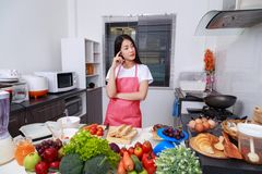 Woman thinking about cooking in kitchen room. At home royalty free stock image