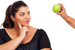 Woman thinking diet. Cute plus size young woman thinking about going on diet stock image