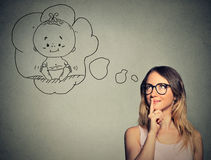 Woman thinking dreaming of a child Stock Images