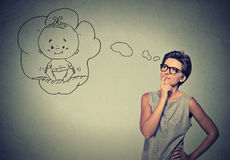 Woman thinking dreaming of a child Royalty Free Stock Photography