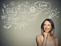Woman thinking dreaming has many ideas looking up Royalty Free Stock Photography